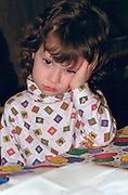Girl age 3 pouting with hand on head.  St Paul  Minnesota USA
