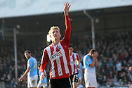 Brentford's George Saville celebrates after he scores his sides 2nd goal. Skybet football league one match , Brentford v Bradford City at Griffin Park in Brentford, London  on Saturday 8th March 2014.<br /> pic by John Fletcher, Andrew Orchard sports photography.