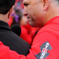 """10 November 2012: Rutgers Scarlet Knights head coach Kyle Flood gives an interview with the Rutgers """"Strong"""" logo raising awareness for Hurricane Sandy relief programs during NCAA college football action between the Rutgers Scarlet Knights and Army Black Knights at High Point Solutions Stadium in Piscataway, N.J.. Rutgers defeated Army 28-7."""