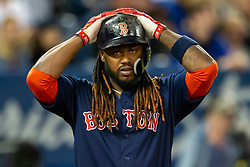 May 11, 2018 - Toronto, ON, U.S. - TORONTO, ON - MAY 11: Boston Red Sox designated hitter Hanley Ramirez (13) adjusts his helmet during the third inning at an MLB game against the Toronto Blue Jays on May 11, 2018, at Rogers Centre in Toronto, ON, Canada. (Photo by Kevin Sousa/Icon Sportswire) (Credit Image: © Kevin Sousa/Icon SMI via ZUMA Press)