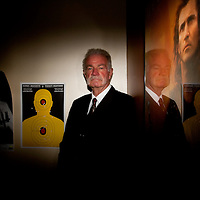 GAINESVILLE, FL -- August 18, 2010 -- Pastor Terry Jones poses for a portrait in his office under bullet ridden targets and a Braveheart poster at the Dove World Outreach Center in Gainesville, Fla., on Wednesday, August 18, 2010.  The church is planning on burning multiple copies of the Koran on the anniversary of the September 11th terrorist attacks.  (Chip Litherland for The New York Times)