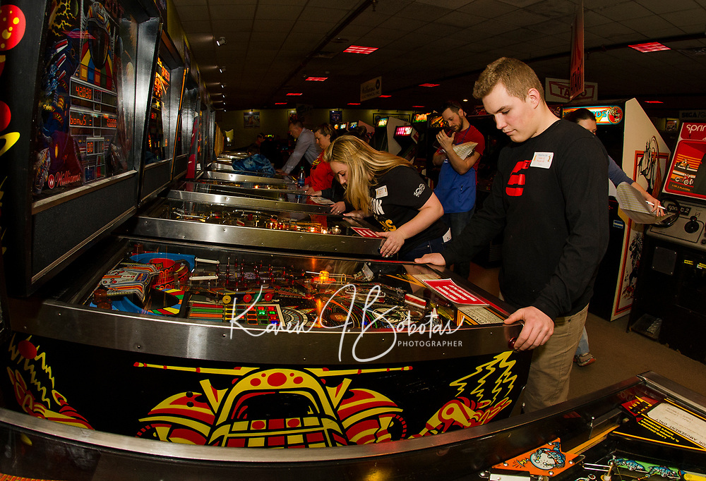 Team FSB (Franklin Savings Bank) lines up for the Pin Ball portion of the NH Humane Society Indoor Triathlon at Funspot on Saturday.  (l-r) Rachel Marland, Tabitha Gerry, Shaunte Currier and Jake Currier with Michael Morbois keeping score.   (Karen Bobotas/for the Laconia Daily Sun)