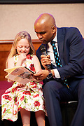 """07/04/2019 repro free: Ella Ward 2nd Class Kiltirenan NS with her book  """"The Teacher with the Crazy Ideas""""   and Paul Sleem MC at  Write a Book organised by The Galway Education centre and help at the Salthill Hotel  . Photo: Andrew Downes, Xposure"""