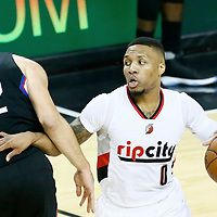 23 April 2016: Portland Trail Blazers guard Damian Lillard (0) drives past Los Angeles Clippers forward Blake Griffin (32) during the Portland Trail Blazers 96-88 victory over the Los Angeles Clippers, during Game Three of the Western Conference Quarterfinals of the NBA Playoffs at the Moda Center, Portland, Oregon, USA.