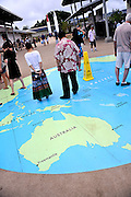 "Tourists stand on a map of the world, including the incorrectly spelled ""Freemantle"" (correctly ""Fremantle"") at the USS Arizona Memorial Museum and Visitor Center, Pearl Harbour, Hawaii. RIGHTS MANAGED LICENSE AVAILABLE FROM www.PhotoLibrary.com"
