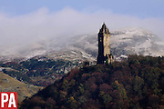 The first snows to hit the hills of Scotland in 2015, behind the Wallace Monument <br /> <br /> © PRESS ASSOCIATION