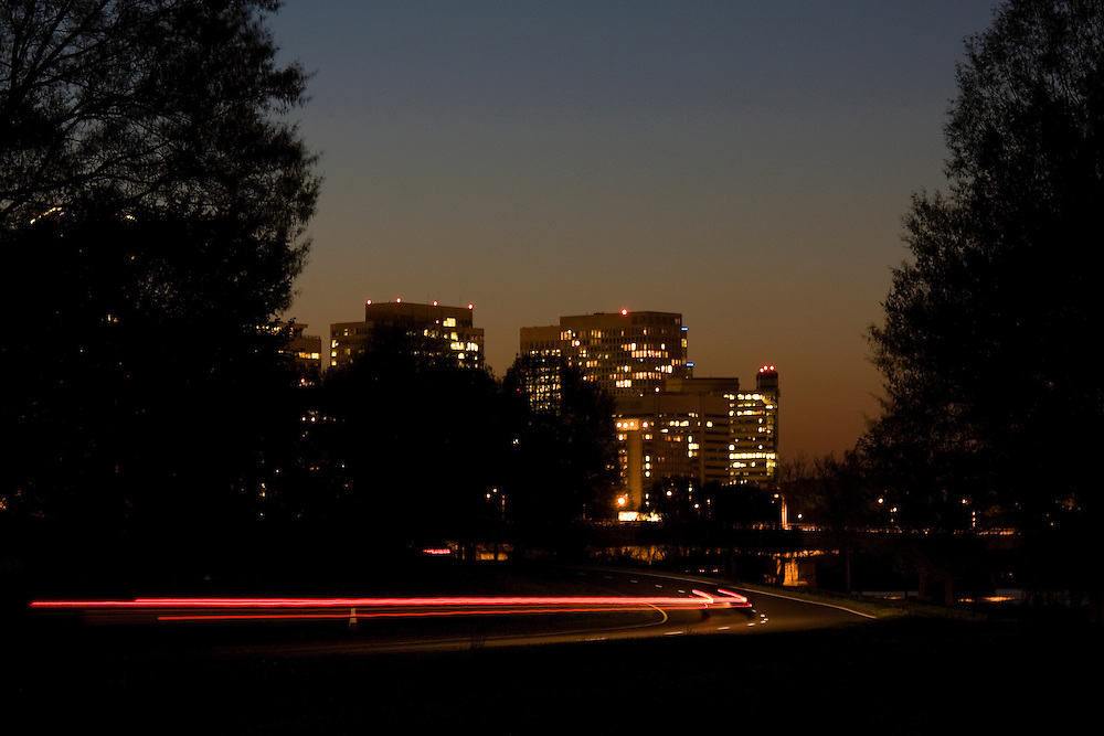 Night falls on a lone car as it heads home near Rosslyn, Virginia, long after the Washington, DC rush hour has subsided.