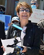 Mineola, NY, USA. April 26, 2021. MARGARET MAHER, from non-profit Food and Water Watch, speaks at rally. Faced with a 26% rate increase from New York American Water going into effect May 1, 2021, activists and residents who are NYAW customers rally to urge NYS Assembly to push through legislation, before that date, corresponding with NYS Senate Bill S989A to establish a Nassau County Water Authority.