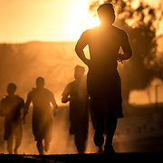 Runners at sunset at Spartan Race Sprint in Chino, Ca on January 27th, 2019.