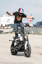 Chris Theis takes a break from announcing and hops in the stunting saddle at the 2016 ROT (Republic of Texas Rally). Austin, TX, USA. June 11, 2016.  Photography ©2016 Michael Lichter.
