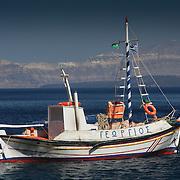 Fishing boat in blue waters near Thirassia (Thirassia, Greece - Jun. 2008) (Image ID: 080628-1708152a)