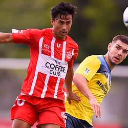 BRISBANE, AUSTRALIA - MARCH 4: Zelfy Nazary of Olympic and Keagan Sheridan of Thunder compete for the ball during the NPL Queensland Senior Mens Round 5 match between Olympic FC and SWQ Thunder at Goodwin Park on March 4, 2017 in Brisbane, Australia. (Photo by Patrick Kearney/Olympic FC)
