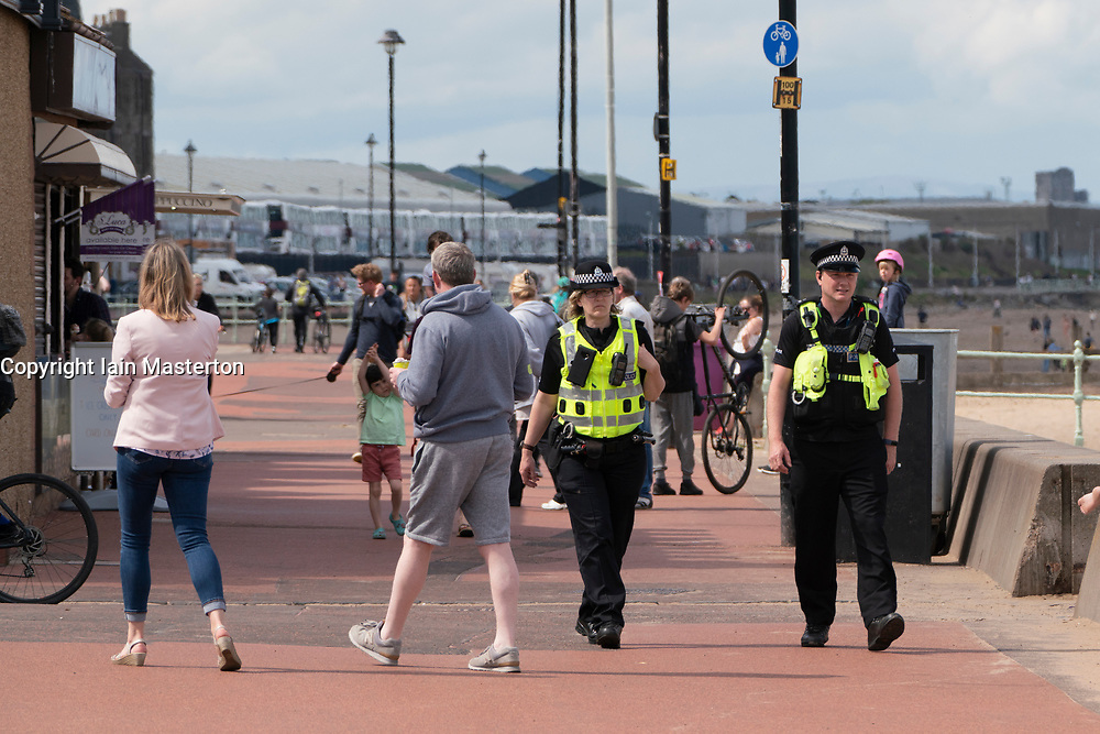 Portobello, Scotland, UK. 9 May 2020. Images from holiday weekend Saturday afternoon during Covid-19 lockdown on promenade at Portobello. Promenade and beach were relatively quiet with a low key police presence. Pictured; Police patrol on the promenade.  Iain Masterton/Alamy Live News