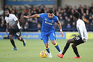 AFC Wimbledon striker Andy Barcham (17) dribbling and taking on Peterborough United midfielder Leo Da Silva Lopes (18) during the EFL Sky Bet League 1 match between AFC Wimbledon and Peterborough United at the Cherry Red Records Stadium, Kingston, England on 12 November 2017. Photo by Matthew Redman.