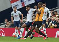 Football - 2019 / 2020 Premier League - Tottenham Hotspur vs. Wolverhampton Wanderers<br /> <br /> Sreven Bergwijn Christian Eriksen (Tottenham FC)  and Willy Boly (Wolverhampton Wanderers) at The Tottenham Hotspur Stadium.<br /> <br /> COLORSPORT/DANIEL BEARHAM