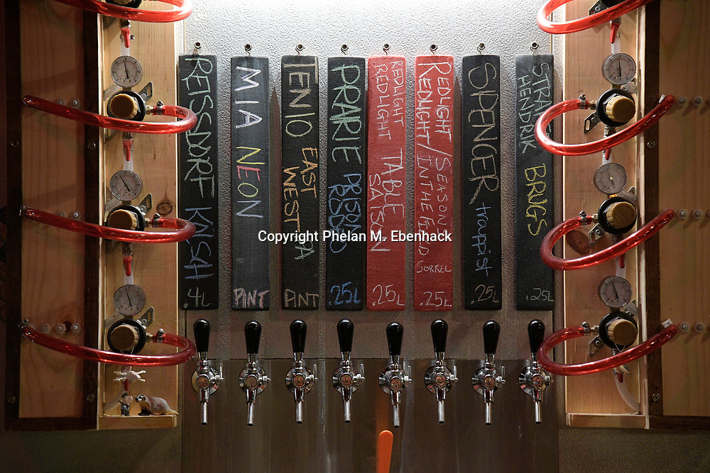 Beer taps are shown on a wall behind the bar at Redlight Redlight Beer Parlour in the Audubon Park neighborhood Friday, Sept. 22, 2017, in Orlando, Fla. (Photo by Phelan M. Ebenhack)