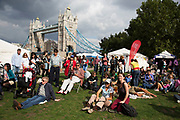 People gathering to hang out, listen to bands and other activities at the Blue Ribbon Village. Totally Thames takes place over the whole month in September, combining arts, cultural and river events presented by Thames Festival Trust throughout the 42-mile stretch of the River Thames in London, UK.