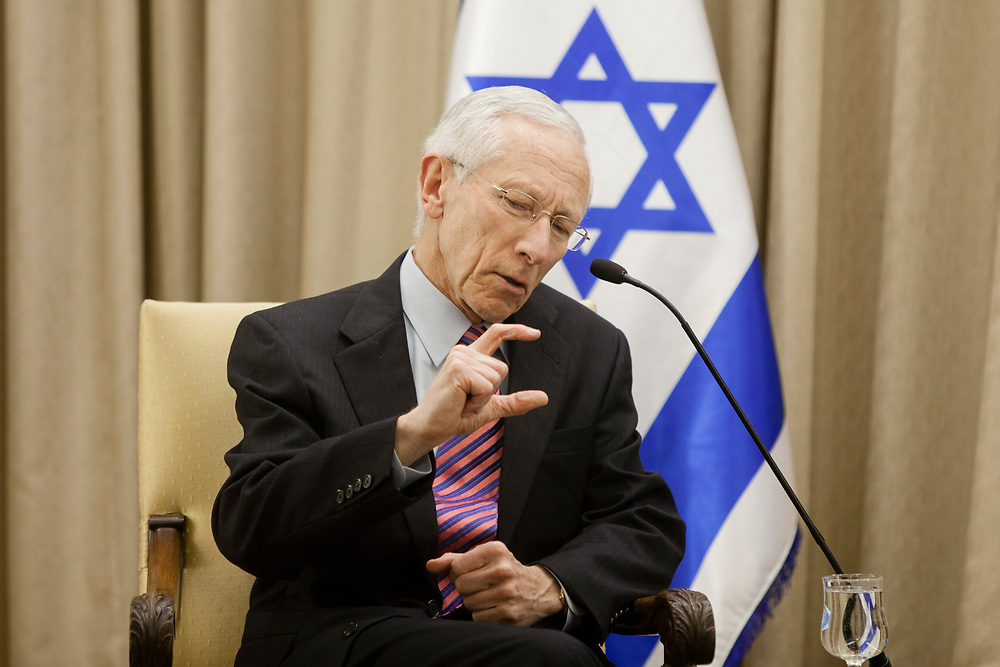 Governor of the Bank of Israel Stanley Fischer gestures as he speaks during the presentation of the 2012  Bank of Israel annual report to Israel's President (not pictured) at the Israeli President's Residence in Jerusalem, on April 2, 2013.