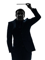 one  business man holding shielding digital tablet in silhouette on white background
