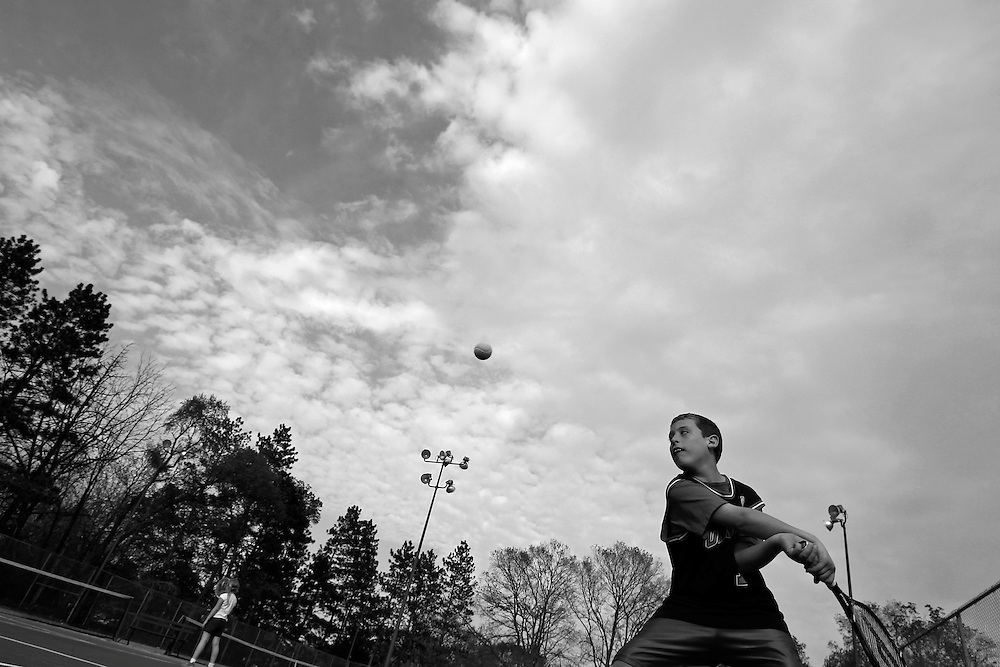 Parker Roos, who suffers from Fragile X, plays tennis at a court near their home in Canton, Illinois, April 4, 2012. REUTERS/Jim Young