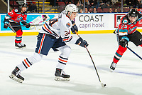 KELOWNA, BC - OCTOBER 12: Reese Belton #34 of the Kamloops Blazers passes the puck against the Kelowna Rockets at Prospera Place on October 12, 2019 in Kelowna, Canada. (Photo by Marissa Baecker/Shoot the Breeze)
