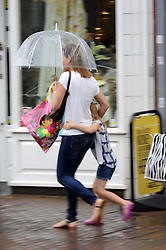 © Licensed to London News Pictures. 07/06/2014<br /> Pouring rain in Kent.<br /> A wet start to the weekend this Morning (07.06.2014) as shoppers in Orpington High Street,Orpington,Kent get their umbrellas out as the rainy weather hits.<br /> Photo credit :Grant Falvey/LNP