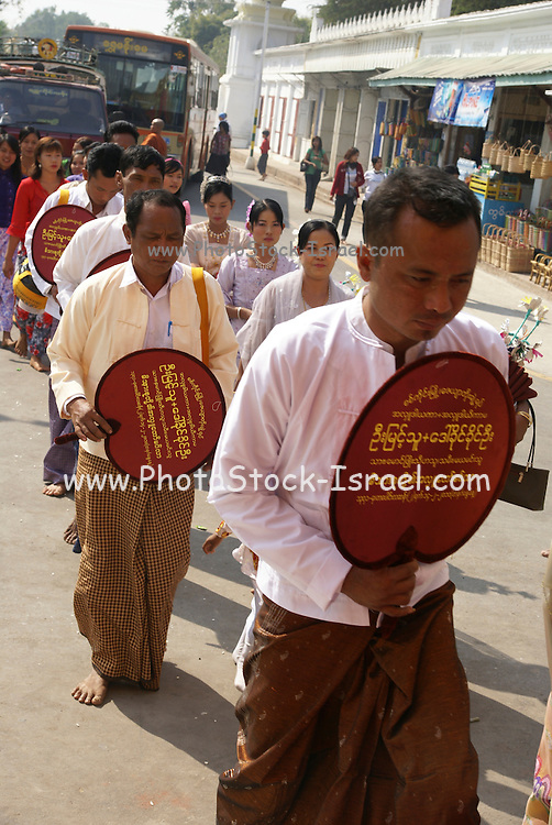 Myanmar, Sagaing, Kaung Hmu daw Pagoda. Shin Pyu Ceremony - Ordination ceremonary for Myanmar Buddhists Children are joining the monastery