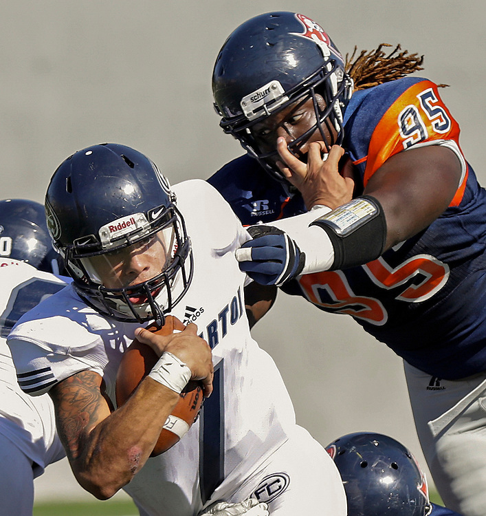 Katja Liebing/Sports Shooter Academy<br /> Fullerton Hornet's Steve Everette tries to fight off a tackle by Orange Coast Pirate's Keith Ford in a conference game at Orange Coast College in Costa Mesa on Saturday, Nov. 5, 2016. Fullerton won 35-14 and continues it's winning streak.