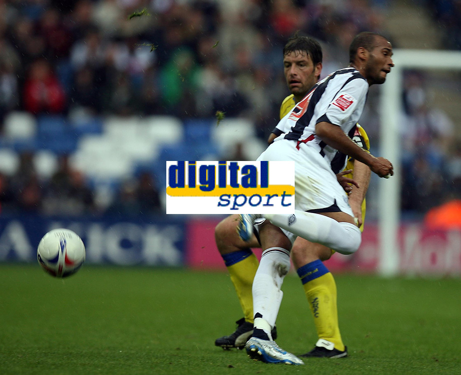 Photo: Rich Eaton.<br /> <br /> West Bromwich Albion v Leeds United. Coca Cola Championship. 30/09/2006. Diomansy Kamara #15 , man of the match of West Brom flicks the ball past the Leeds defence