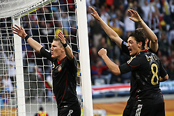 03.07.2010, CAPE TOWN, SOUTH AFRICA,Bastian Schweinsteiger of Germany and Mesut Oezil of Germany celebrate Germany's third goal  during the Quarter Final, Match 59 of the 2010 FIFA World Cup, Argentina vs Germany held at the Cape Town Stadium EXPA Pictures © 2010, PhotoCredit: EXPA/ nph/  Kokenge