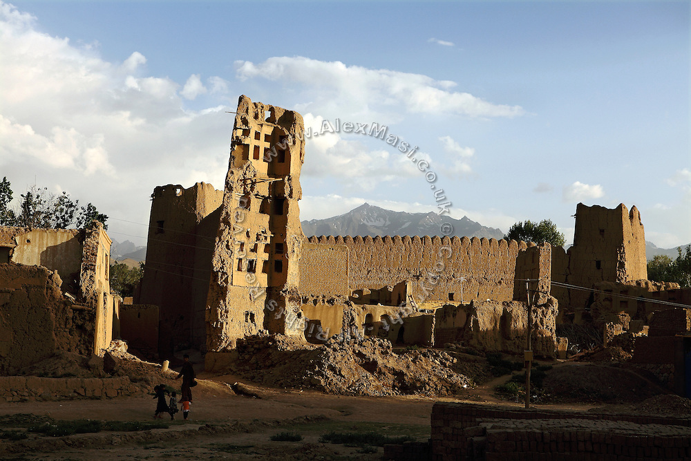 An old building in ruins is photographed in Bamiyan, in the heart of the Hindu Kush mountain range, central Afghanistan. The Buddhas of Bamiyan were two 6th century monumental statues of standing Buddhas carved into the side of a cliff in the Bamiyan valley in the Hazarajat region of central Afghanistan, situated 230 km northwest of Kabul at an altitude of 2500 meters. The statues represented the classic blended style of Gandhara art. The main bodies were hewn directly from the sandstone cliffs, but details were modelled in mud mixed with straw, coated with stucco. Amid widespread international condemnation, the smaller statues (55 and 39 meters respectively) were intentionally dynamited and destroyed in 2001 by the Taliban because they believed them to be un-Islamic idols. Once a stopping point along the Silk Road between China and the Middle East, researchers think Bamiyan was the site of monasteries housing as many as 5,000 monks during its peak as a Buddhist centre in the 6th and 7th centuries. It is now a UNESCO Heritage Site since 2003. Archaeologists from various countries across the world have been engaged in preservation, general maintenance around the site and renovation. Professor Tarzi, a notable An Afghan-born archaeologist from France, and a teacher in Strasbourg University, has been searching for a legendary 300m Sleeping Buddha statue in various sites between the original standing ones, as documented in the old account of a renowned Chinese scholar, Xuanzang, visiting the area in the 7th century. Professor Tarzi worked on projects to restore the other Bamiyan Buddhas in the late 1970s and has spent most of his career researching the existence of the missing giant Buddha in the valley.