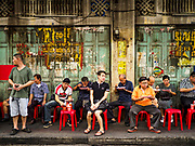 """18 MAY 2017 - BANGKOK, THAILAND: People sit on plastic stools and eat Thai curries at Jek Pui curry stand, a popular street food stall for curry dishes. City officials in Bangkok have taken steps to rein in street food vendors. The steps were originally reported as a """"ban"""" on street food, but after an uproar in local and international news outlets, city officials said street food vendors wouldn't be banned but would be regulated, undergo health inspections and be restricted to certain hours on major streets. On Yaowarat Road, in the heart of Bangkok's touristy Chinatown, the city has closed some traffic lanes to facilitate the vendors. But in other parts of the city, the vendors have been moved off of major streets and sidewalks.      PHOTO BY JACK KURTZ"""