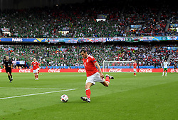 Gareth Bale of Wales crosses the ball which leads to an own GOAL from Gareth McAuley of Northern Ireland  - Mandatory by-line: Joe Meredith/JMP - 25/06/2016 - FOOTBALL - Parc des Princes - Paris, France - Wales v Northern Ireland - UEFA European Championship Round of 16