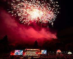 Edinburgh, Scotland, UK. 27 August, 2018. The Edinburgh International Festival concluded with the Virgin Money Fireworks Concert in Princes Street Gardens with a backdrop of Edinburgh Castle. Music by the Scottish Chamber Orchestra playing The Planets by Gustav Holst.