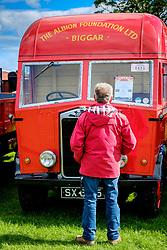 The 44th Biggar Vintage Vehicle Rally held in Biggar on 13th August 2017.  An enthusiast admiring a vintage vehicle.<br /> <br /> (c) Andrew Wilson   Edinburgh Elite media