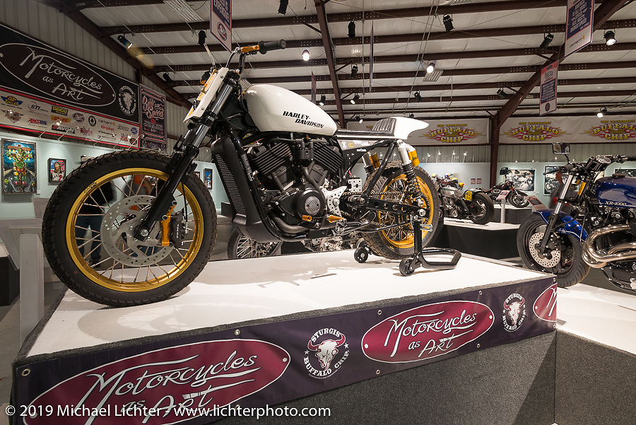 """Brandon Holstein's custom Street 500 in the """"Built for Speed"""" exhibition curated by Michael Lichter and Paul D'Orleans in the Russ Brown Events Center as part of the annual """"Motorcycles as Art"""" series at the Sturgis Buffalo Chip during the Black Hills Motorcycle Rally. SD, USA. August 5, 2014.  Photography ©2014 Michael Lichter."""