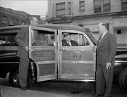 """Ackroyd 00078-49. """"Western Skyways. March 21, 1947. Station wagon."""" Parked in front of Wolfard Motor Co., 1207 West Burnside. Across the street from the Crystal Hotel. Mecca Hotel sign."""