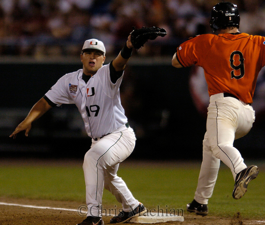 06/19/2006 Miami first baseman  Yonder Alonso stretches to make the catch Oregon State's Cole Gillespie during game ten of the College World Series in Omaha Nebraska Tuesday evening..(photo by Chris Machian/Prairie Pixel Group)