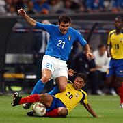 Ecuador's Edwin Tenorio tackles Italy's Christian Vieri