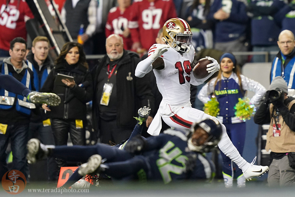 December 29, 2019; Seattle, Washington, USA; San Francisco 49ers wide receiver Deebo Samuel (19) runs past Seattle Seahawks defensive back Lano Hill (42) during the first quarter at CenturyLink Field.