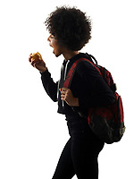 one mixed race african young teenager girl woman eating apple in studio shadow silhouette isolated on white background