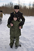 Kronstadt, Russia, 21/02/2004..11 year old Ivan Mishukov is a student at the Naval Kadetskii Korpus, the school of the elite Kronstadt Naval Academy. Abandoned by his alcoholic parents at the age of 3, Ivan lived for 2 years with a pack of wild dogs in his home town of Reutov before being rescued by police and taken to a children's home; he was subsequently adopted by Tatiana Bababina..Ivan and his clasmates on a school military exercise.