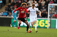 Marouane Fellaini of Manchester Utd holds off Alfie Mawson of Swansea city (r). .Premier league match, Swansea city v Manchester Utd at the Liberty Stadium in Swansea, South Wales on Sunday 6th November 2016.<br /> pic by  Andrew Orchard, Andrew Orchard sports photography.