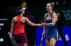 October 26, 2018 - Kallang, SINGAPORE - Gabriela Dabrowski of Canada & Yifan Xu of China in action during their doubles quarterfinal match at the 2018 WTA Finals tennis tournament (Credit Image: © AFP7 via ZUMA Wire)