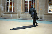 Philip Larkin statue, railway station concourse, Hull, Yorkshire, England