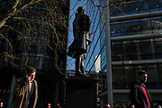 City Men beneath the statue of Member of parliament and Mayor John Wilkes 1727-1797 on 13th February 2017, in London, United Kingdom.
