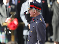 The Prince of Wales salutes during the remembrance service at the Cenotaph memorial in Whitehall, central London, on the 100th anniversary of the signing of the Armistice which marked the end of the First World War.