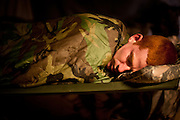 A U.S. soldier sleeps on a cot at Combat Outpost Terminator.