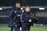 AFC Wimbledon interim manager Simon Bassey and AFC Wimbledon coach Steven Reid walking off the field during the EFL Sky Bet League 1 match between AFC Wimbledon and Southend United at the Cherry Red Records Stadium, Kingston, England on 24 November 2018.