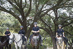 August 19, 2017 - Houston, TX, USA - Houston Police Department's mounted officers occupy space between Black Lives Matter protestors and armed counter-protestors assembled outside Sam Houston Park in downtown Houston, Texas, where Black Lives Matter called for the removal of confederate monuments in the city. (Credit Image: © Scott W. Coleman via ZUMA Wire)